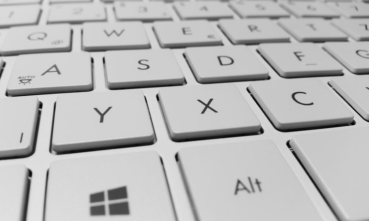 How to clean under a laptop keyboard without removing keys